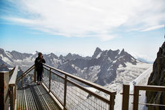 Chamonix Mont Blanc, France. Chamonix Mont-Blanc, France - July 19, 2017: Traveler enjoying Alpine panorama, Famous Tower Aiguille du Midi 3842m. Mont Blanc Royalty Free Stock Photo