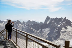 Chamonix Mont Blanc, France. Chamonix Mont-Blanc, France - July 19, 2017: Traveler enjoying Alpine panorama, Famous Tower Aiguille du Midi 3842m. Mont Blanc Stock Image
