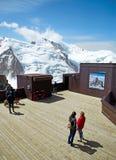 Chamonix Mont Blanc, France. Chamonix Mont-Blanc, France - July 19, 2017: Travelers enjoying Alpine panorama, Famous Tower Aiguille du Midi 3842m. Mont Blanc Stock Photo