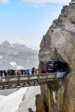 Chamonix Mont Blanc, France. Chamonix Mont-Blanc, France - July 19, 2017: Travelers enjoying Alpine panorama, Famous Tower Aiguille du Midi 3842m. Mont Blanc Royalty Free Stock Photos