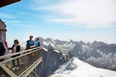 Chamonix Mont Blanc, France. Chamonix Mont-Blanc, France - July 19, 2017: Travelers enjoying Alpine panorama, Famous Tower Aiguille du Midi 3842m. Mont Blanc Stock Photography