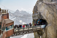 Chamonix Mont Blanc, France. Chamonix Mont-Blanc, France - July 19, 2017: Travelers enjoying Alpine panorama, Famous Tower Aiguille du Midi 3842m. Mont Blanc Royalty Free Stock Photography