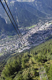 Chamonix panorama. Aerial view of French city of Chamonix, as seen from cable car going up Aiguille du Midi stock photography