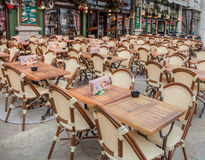 Chamonix Restaurants. Chamonix, France, Table and chairs ready for customers at popular restaurants at Rue du Docteur Paccard, Chamonix, France.Picture was taken Royalty Free Stock Photos