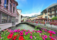Chamonix on summer. CHAMONIX, FRANCE - JULY 31: View of the street in city centre of Chamonix on July 31, 2015. Chamonix is a famous ski resort located in Savoy Stock Photography