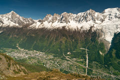 Chamonix town aerial view in mountains. Chamonix town aerial view under mountain peaks of  Mont Blanc massif in France. Popular sports and touristic destination Royalty Free Stock Photo