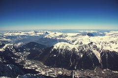 Chamonix valley panoramic aerial view from Aiguille du Midi mountain peak. Popular touristic destination. Royalty Free Stock Images