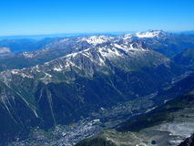 Chamonix village and alpine mountains range landscape seen from Aiguille du Midi. Alpine mountains range landscape in beauty French, Italian and Swiss ALPS seen Royalty Free Stock Image
