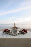 Champán en la playa Fotografía de archivo