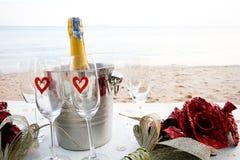 Champán en la playa Imágenes de archivo libres de regalías