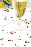 Champán y confeti Imagen de archivo libre de regalías