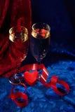 Champán y corazón Imágenes de archivo libres de regalías