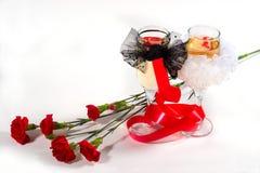 Champán y flores Fotos de archivo libres de regalías