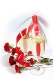 Champán y flores Imagen de archivo libre de regalías