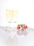 Champán y rosas Imagen de archivo libre de regalías