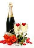 Champán y rosas Fotos de archivo