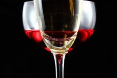 Champán y vino rojo Imagenes de archivo