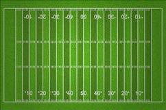 Champ de football américain avec des lignes d'herbe d'obscurité et de lumière Images libres de droits