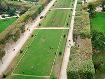 Champ de Mars in Paris, France. The Field of Mars Champ de Mars in Paris in France. Strolling people, green grass and trees. View from above Royalty Free Stock Photos
