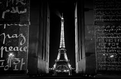 Champ de Mars Peace Monument and Eiffel Tower. The Champ de Mars peace monument frames the Eiffel Tower at night.  The Wall for Peace has peace written in 32 Royalty Free Stock Photos