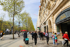 Champ Elysee, Paris. Apr 16 2015,Shoppers and tourists in Paris on  enjoy the sights on the well known Champ Elysee. Champ Elysee is arguably the most famous Stock Image