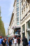 Champ Elysee, Paris. Apr 16 2015,Shoppers and tourists in Paris on  enjoy the sights on the well known Champ Elysee. Champ Elysee is arguably the most famous Royalty Free Stock Photos