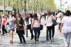 Champ Elysee street, Paris. Apr 16 2015,Shoppers and tourists in Paris on  enjoy the sights on the well known Champ Elysee. Champ Elysee is arguably the most Royalty Free Stock Images