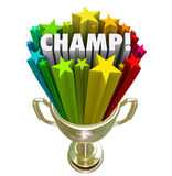 Champ Gold Trophy Award Winner Stars Fireworks. The word Champ in a gold trophy with colorful stars or fireworks around it to illustrate the winner or best Royalty Free Stock Photo