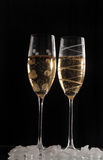 Champage glasses on black background. Two Champage glasses on black background ice cubes Stock Photo