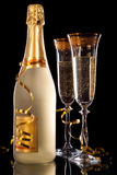 Champagne. Glasses of champagne with bottle Royalty Free Stock Photos