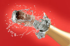 Champagne. Bottle  on a red background Stock Photography