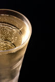 Champagne. Closeup of chilled champagne glass with copy space Royalty Free Stock Images