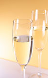 Champagne. Two champagne glasses on gold background royalty free stock photo