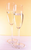 Champagne. Two champagne glasses on gold background royalty free stock photography
