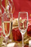 Champagne. Gold christmas ornaments with champagne on christmas time stock photos