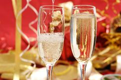 Champagne. Gold christmas ornaments with champagne on christmas time royalty free stock images