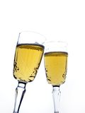 Champagne. Two flutes of champagne over white Stock Images