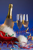 Champagne. With two glasses close up on blue Royalty Free Stock Image