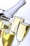Champagne. Glasses with ice bucket on white background Stock Photo