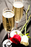 Champagne. Two Bubbly champagne glasses with roses Stock Image