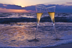 Champagne. Two Champagne Glasses on the Beach at Sunset Royalty Free Stock Photography