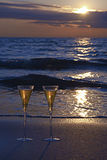 Champagne. Two Champagne Glasses on the Beach at Sunset Stock Photos