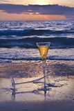 Champagne. Two Champagne Glasses on the Beach at Sunset Stock Photo