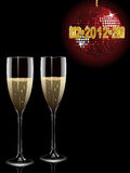 Champagne and 2012 disco ball. Champagne filled flutes under a sparkling red disco ball with a gold 2012 mosaic sign Royalty Free Stock Photo