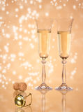 Champagne. Pair of champagne glasses on sparkle background, focused on cork Royalty Free Stock Photo