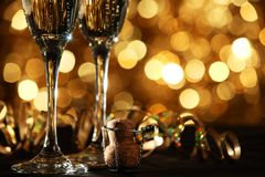 Champagne. Flutes of champagne in holiday setting,Shallow Dof Stock Photo