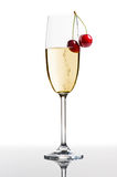 Champagne. Flute with cherries, on white background Stock Image