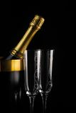 Champagne. Close up of a champagne bottle and a glasses over black background Stock Image