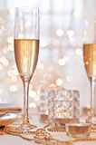 Champagne. Glass of champagne against golden background Stock Image
