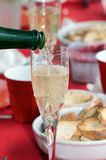 Champagne. Nobody pouring a glass of champagne glass for an aperitif party with tapas Stock Images